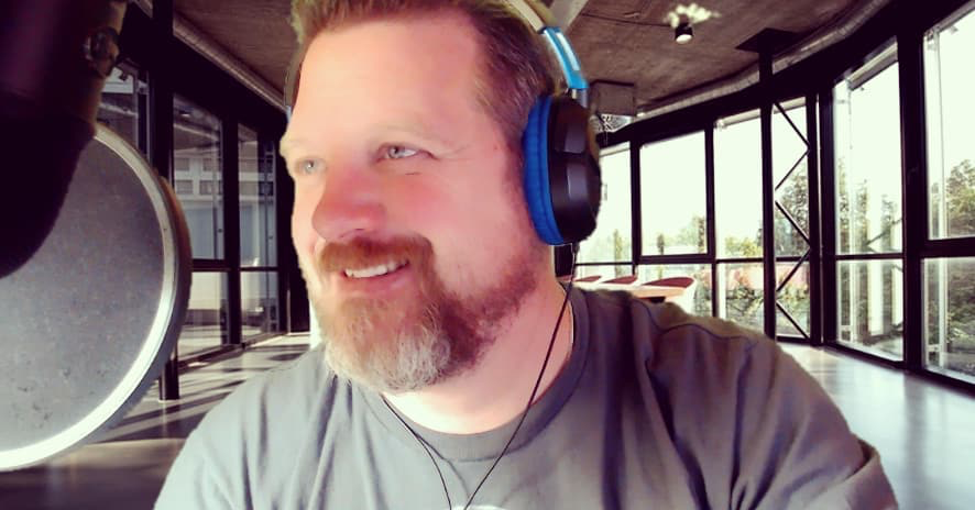 Pic of Donnie Boivin podcasting with headphones on