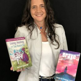 Picture of Laura Di Franco holding two books